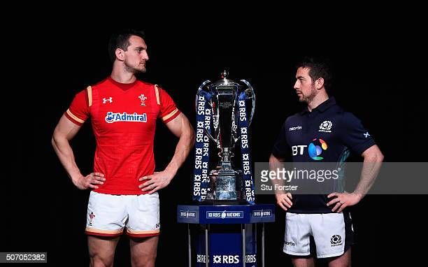 Sam Warburton captain of Wales and Greig Laidlaw captain of Scotland pose with the trophy during the RBS Six Nations launch at The Hurlingham Club on...