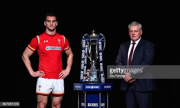 Sam Warburton captain of Wales and head coach Warren Gatland pose with the trophy during the RBS Six Nations launch at The Hurlingham Club on January...