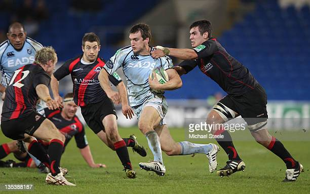 Sam Warburton of Cardiff is held up by Stuart McInally of Edinburgh during the Heineken Cup Pool Two match between Cardiff Blues and Edinburgh at the...