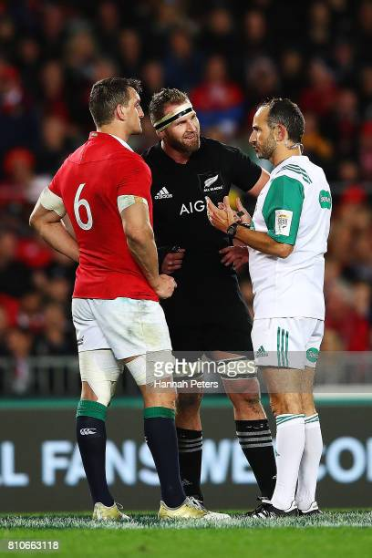 Sam Warburton of the Lions and Kieran Read of the All Blacks talk to referee Romain Poite during the Test match between the New Zealand All Blacks...