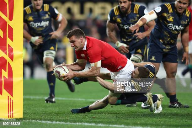 Sam Warburton of the Lions drives through the tackle from Kayne Hammington of the Highlanders to score his team's third try during the 2017 British...