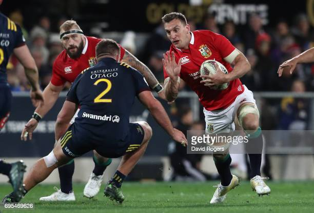 Sam Warburton of the Lions is tackled by Liam Coltman of the Highlanders during the 2017 British Irish Lions tour match between the Highlanders and...