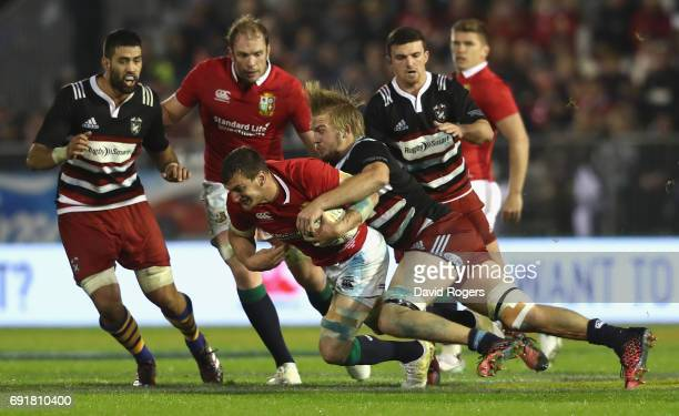 Sam Warburton of the Lions is tackled during the match between the New Zealand Provincial Barbarians and the British Irish Lions at Toll Stadium on...