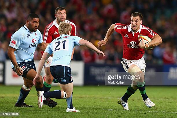 Sam Warburton of the Lions runs the ball during the match between the NSW Waratahs and the British Irish Lions at Allianz Stadium on June 15 2013 in...