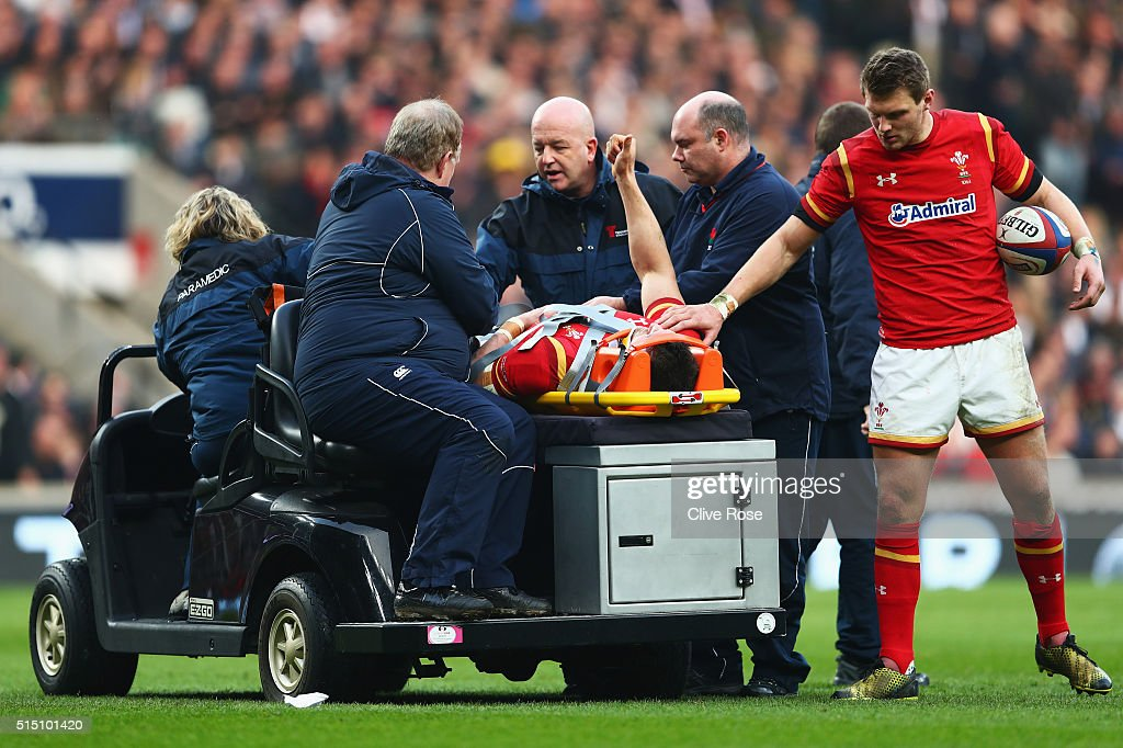 Sam Warburton of Wales gives the thumbs up as he leaves the field on a stretcher with Dan Biggar looking on during the RBS Six Nations match between...