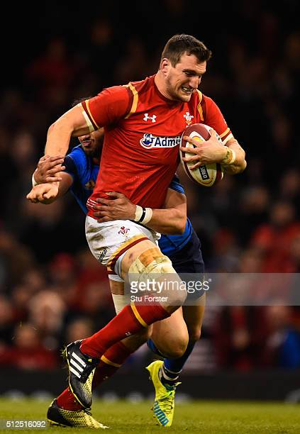 Sam Warburton of Wales is hauled down short of the tryline by Maxime Mermoz of France during the RBS Six Nations match between Wales and France at...
