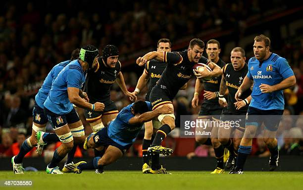 Sam Warburton of Wales is tackled by Andrea Masi of Italy during the International Match between Wales and Italy at Millennium Stadium on September 5...