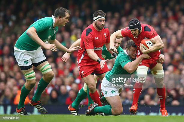 Sam Warburton of Wales is tackled by Jack McGrath of Ireland during the RBS Six Nations match between Wales and Ireland at the Millennium Stadium on...