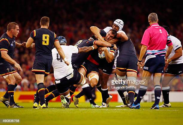 Sam Warburton of Wales is tackled during the 2015 Rugby World Cup Pool A match between Wales and Fiji at the Millennium Stadium on October 1 2015 in...