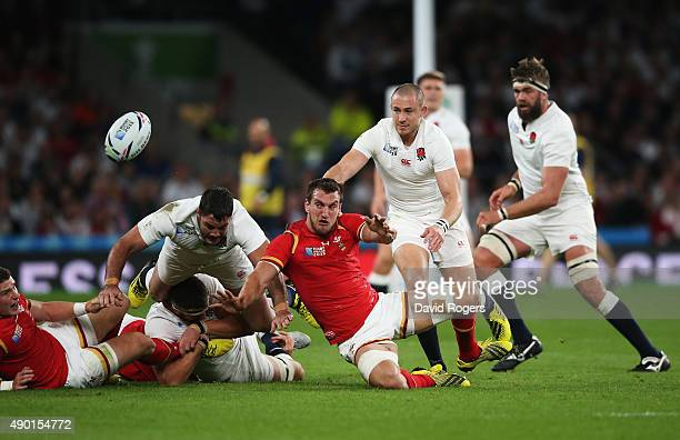 Sam Warburton of Wales passes the ball watched by Mike Brown of England and Brad Barritt of England during the 2015 Rugby World Cup Pool A match...