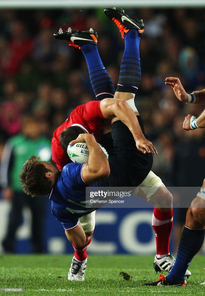 <a gi-track='captionPersonalityLinkClicked' href=/galleries/search?phrase=Sam+Warburton+-+Rugby+Player&family=editorial&specificpeople=4234449 ng-click='$event.stopPropagation()'>Sam Warburton</a> of Wales up ends <a gi-track='captionPersonalityLinkClicked' href=/galleries/search?phrase=Vincent+Clerc&family=editorial&specificpeople=235795 ng-click='$event.stopPropagation()'>Vincent Clerc</a> of France during semi final one of the 2011 IRB Rugby World Cup between Wales and France at Eden Park on October 15, 2011 in Auckland, New Zealand.