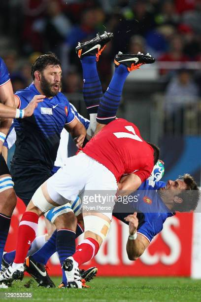 Sam Warburton of Wales up ends Vincent Clerc of France during semi final one of the 2011 IRB Rugby World Cup between Wales and France at Eden Park on...
