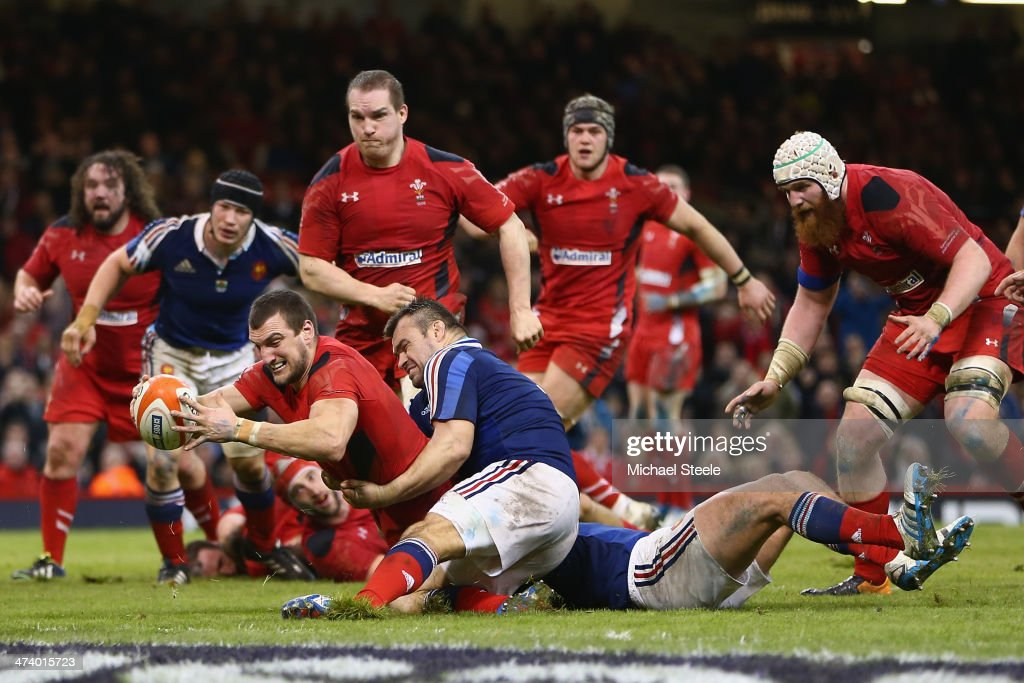 <a gi-track='captionPersonalityLinkClicked' href=/galleries/search?phrase=Sam+Warburton+-+Rugby+Player&family=editorial&specificpeople=4234449 ng-click='$event.stopPropagation()'>Sam Warburton</a> of Walesscores a try as <a gi-track='captionPersonalityLinkClicked' href=/galleries/search?phrase=Nicolas+Mas&family=editorial&specificpeople=598314 ng-click='$event.stopPropagation()'>Nicolas Mas</a> of fails to hold him up during the RBS Six Nations match between Wales and France at the Millennium Stadium on February 21, 2014 in Cardiff, Wales.