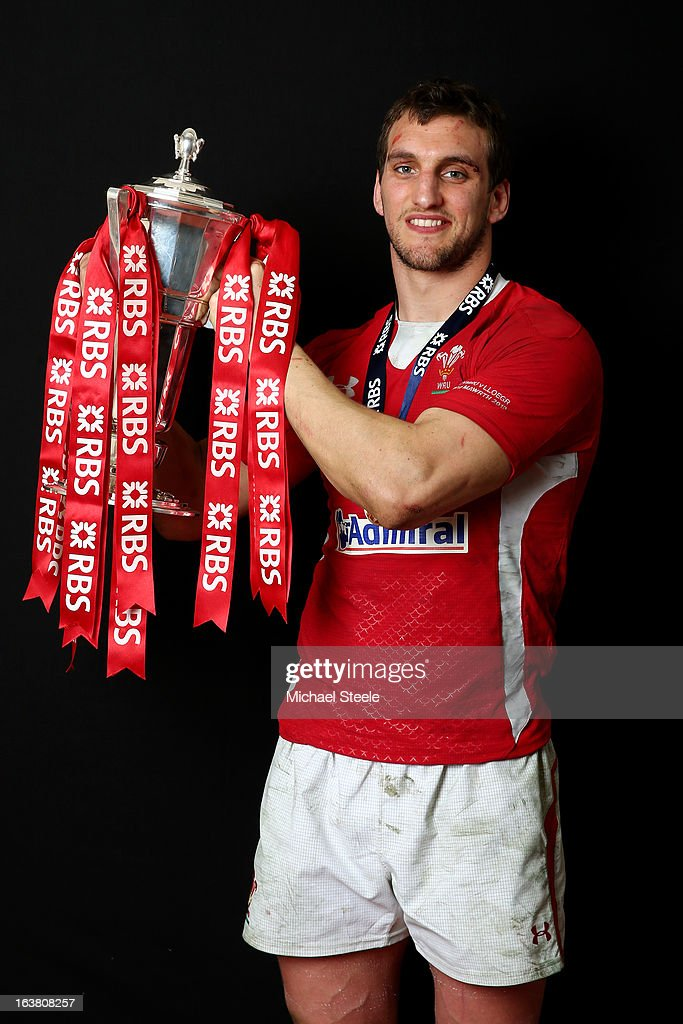 <a gi-track='captionPersonalityLinkClicked' href=/galleries/search?phrase=Sam+Warburton+-+Rugby+Player&family=editorial&specificpeople=4234449 ng-click='$event.stopPropagation()'>Sam Warburton</a> poses with the Six Nations trophy following his team's victory during the RBS Six Nations match between Wales and England at Millennium Stadium on March 16, 2013 in Cardiff, Wales.