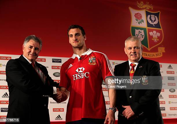 Sam Warburton The British and Irish Lions Captain shakes hands with Andy Irvine the British and Irish Lions Tour Manager and Warren Gatland the...