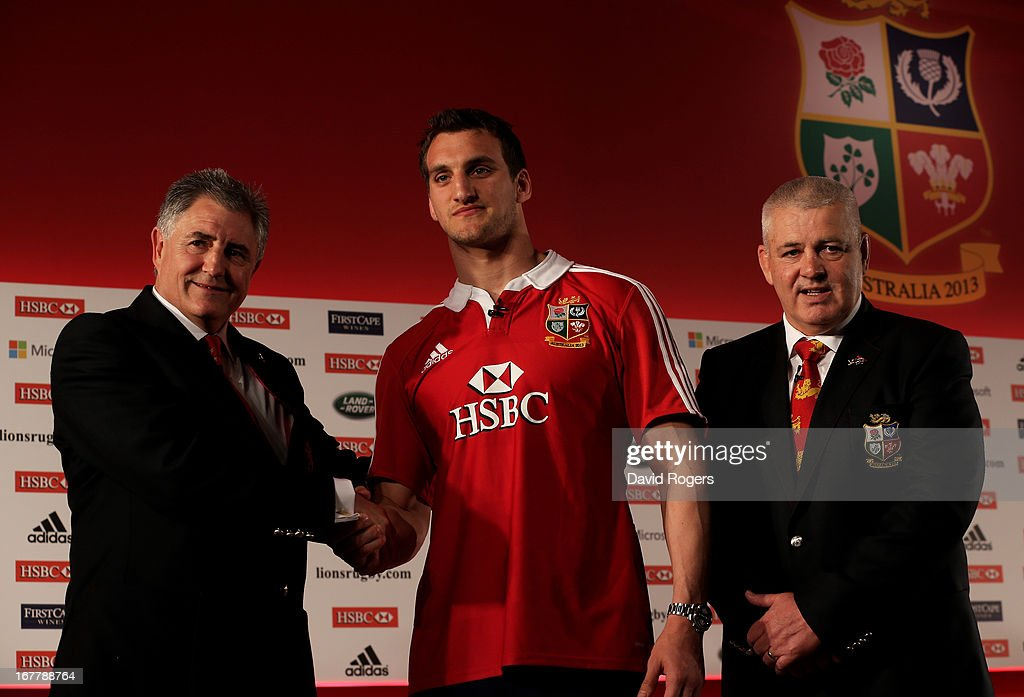 Sam Warburton (C) The British and Irish Lions Captain shakes hands with Andy Irvine (L) the British and Irish Lions Tour Manager and Warren Gatland (R) the British and Irish Lions Head Coach during the 2013 British and Irish Lions tour squad and captain announcement at London Syon Park Hotel on April 30, 2013 in London, England.