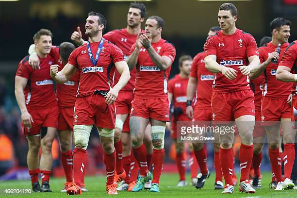 Sam Warburton the captain of Wales and George North lead the celebrations after their sides 2316 victory on a lap of honour during the RBS Six...