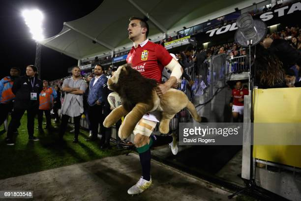Sam Warburton the Lions captain leads his team onto the pitch during the match between the New Zealand Provincial Barbarians and the British Irish...