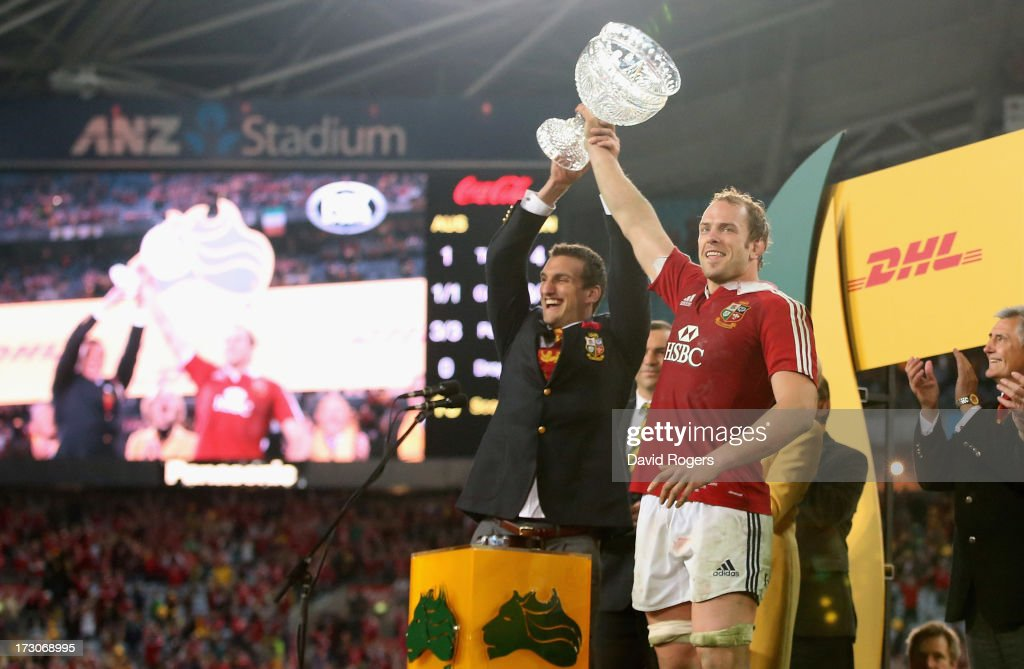 Sam Warburton (L) the Lions tour captain raises the Tom Richards Cup with match captain Alun Wyn Jones after their victory during the International Test match between the Australian Wallabies and British & Irish Lions at ANZ Stadium on July 6, 2013 in Sydney, Australia.