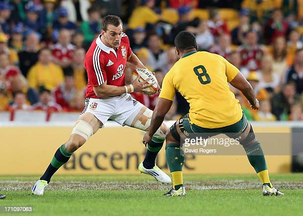 Sam Warbuton of the Lions takes on Wycliff Palu during the First Test match between the Australian Wallabies and the British Irish Lions at Suncorp...