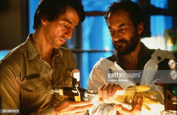 Sam Waterston and Jeffrey DeMunn work in a gene splicing lab in a scene for the 20th Century Fox movie 'Warning Sign' circa 1985