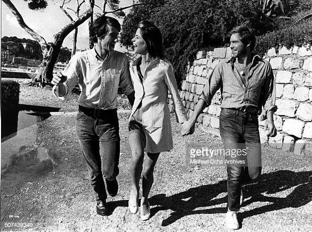 Sam Waterston as Taylor Charlotte Rampling as Marty and Robie Porter as Bert walks together as the three college students wandering through Europe in...