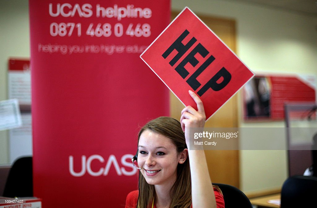 Sam Wathen, an employee in the UCAS clearing house call centre calls for assistance and advice from a supervisor as she answers a student's enquiry as she prepares to assist A-level students ahead of results day on August 18, 2010 in Cheltenham, England. With A-level results published in England and Wales tomorrow, the university admissions service (UCAS) say they are expecting 'even greater' pressure this year during the clearing process - which matches students who have been turned down by their original choices, to other courses. A record 170,000 students will miss out on places at university, which is due to the record number of applicants, up 11.6 percent this year.
