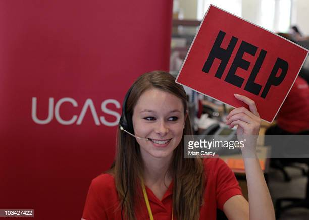 Sam Wathen an employee in the UCAS clearing house call centre calls for assistance and advice from a supervisor as she answers a student's enquiry as...