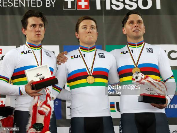 Sam Webster Ethan Mitchell and Edward Dawkins of New Zealand poses with their gold medal after winning the Men's Team Sprint on day one of the 2017...