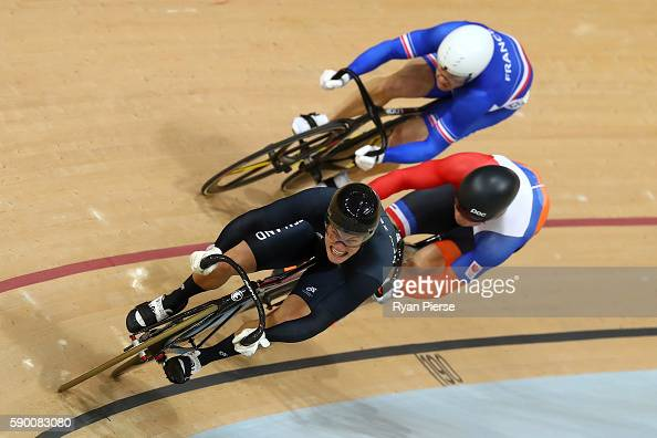 Sam Webster of New Zealand leads Francois Pervis of France and Matthijs Buchli of the Netherlands during a Men's Keirin First Round race on Day 11 of...
