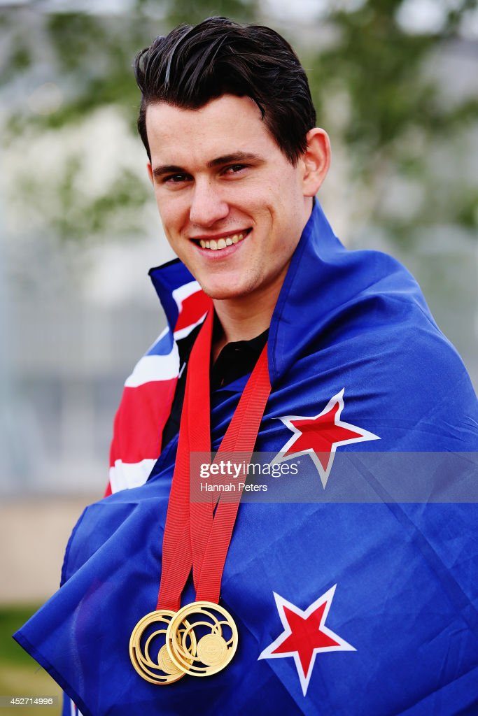 Sam Webster of New Zealand poses with his gold medals during day three of the Glasgow 2014 Commonwealth Games on July 26, 2014 in Glasgow, United Kingdom.