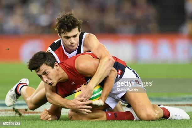 Sam Weideman of the Demons is tackled by Blake Acres of the Saints during the round one AFL match between the St Kilda Saints and the Melbourne...