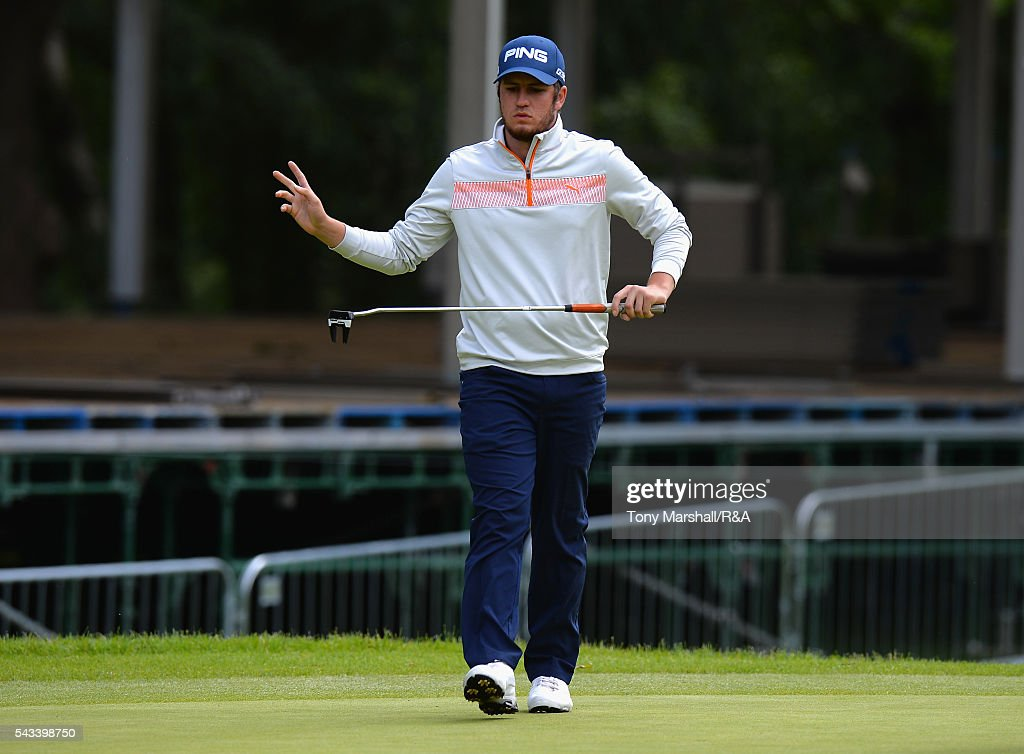 Sam Whitehead of Woburn acknowledges the gallery after putting on the 18th green during the Open Championship Qualifying - Woburn at Woburn Golf Club on June 28, 2016 in Woburn, England.