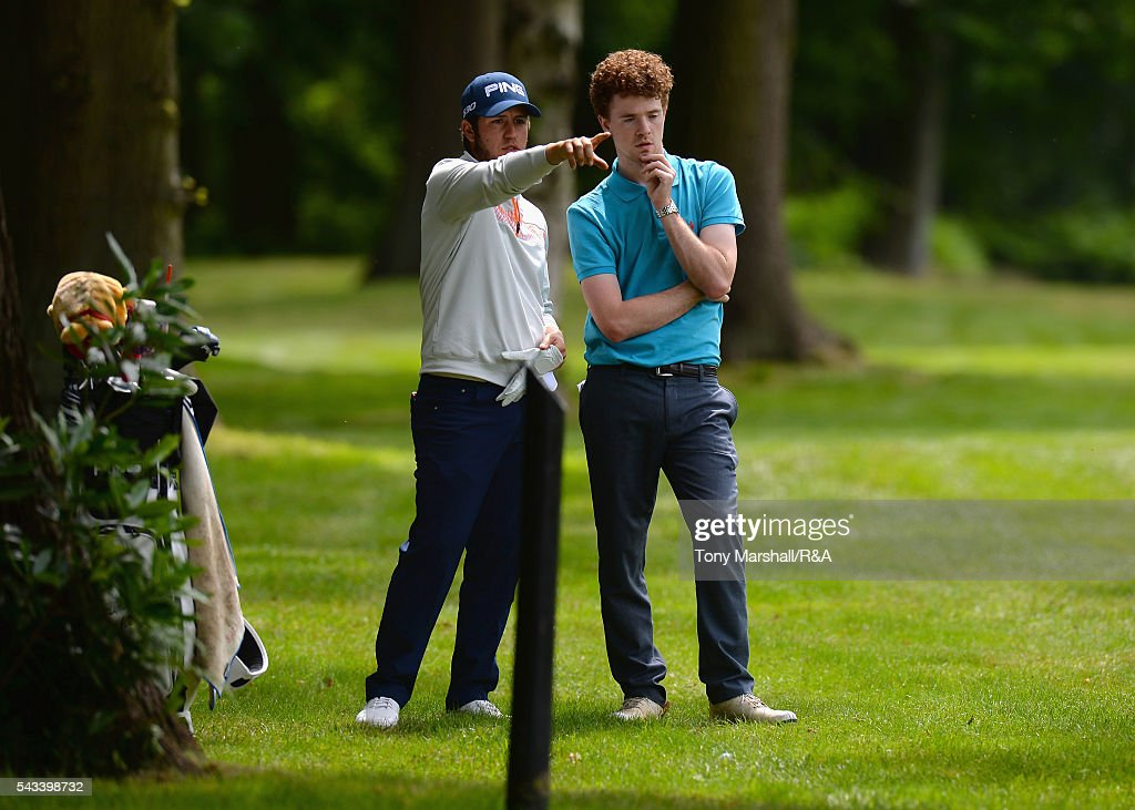 Sam Whitehead of Woburn discusses his line for his second shot with his caddy on the 18th fairway during the Open Championship Qualifying - Woburn at Woburn Golf Club on June 28, 2016 in Woburn, England.