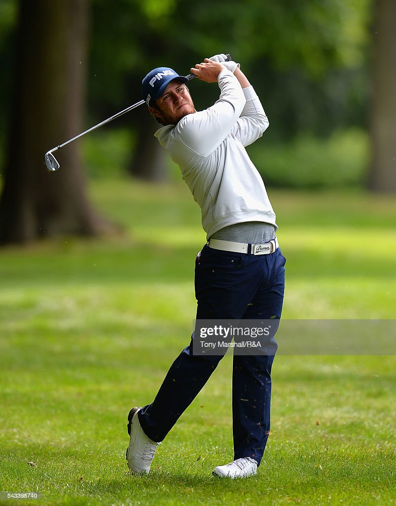 Sam Whitehead of Woburn plays his second shot on the 18th fairway during the Open Championship Qualifying - Woburn at Woburn Golf Club on June 28, 2016 in Woburn, England.