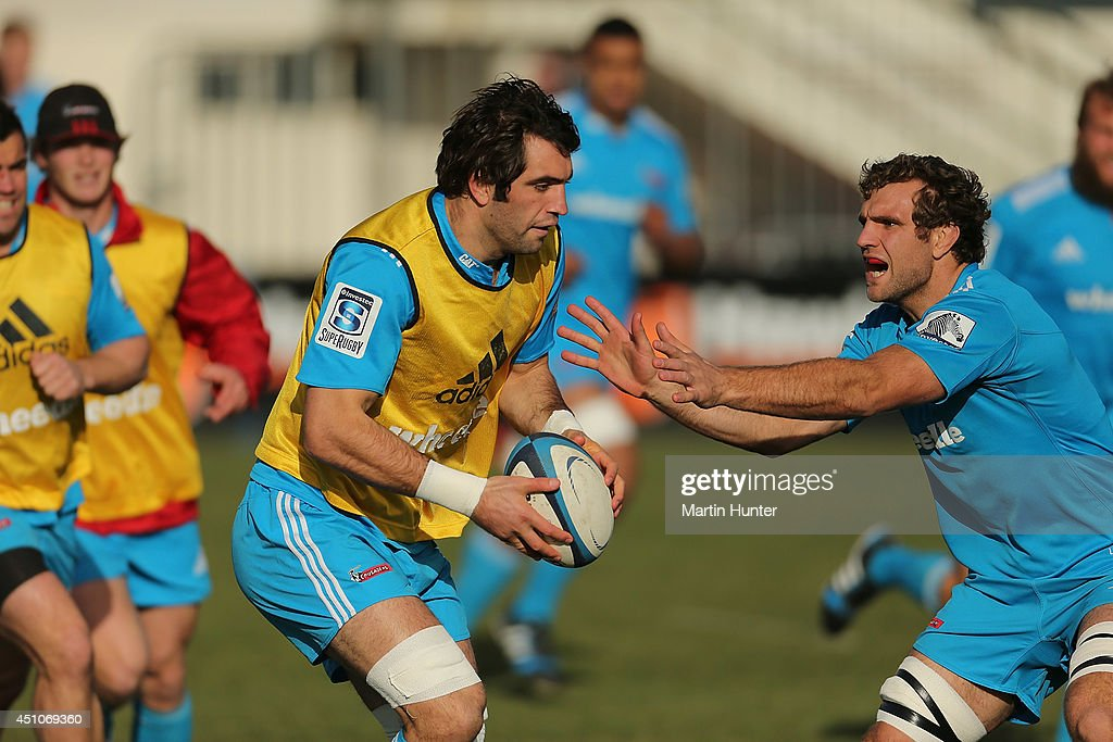 <a gi-track='captionPersonalityLinkClicked' href=/galleries/search?phrase=Sam+Whitelock&family=editorial&specificpeople=6070892 ng-click='$event.stopPropagation()'>Sam Whitelock</a> (C) is tackled by <a gi-track='captionPersonalityLinkClicked' href=/galleries/search?phrase=Luke+Whitelock&family=editorial&specificpeople=7045783 ng-click='$event.stopPropagation()'>Luke Whitelock</a> (R) during a Crusaders Super Rugby training session at Rugby Park on June 23, 2014 in Christchurch, New Zealand.
