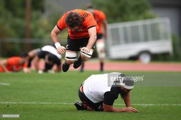 Sam Whitelock leaps over Charlie Faumuina during a New Zealand All Blacks training session at Trusts Stadium on June 22 2017 in Auckland New Zealand