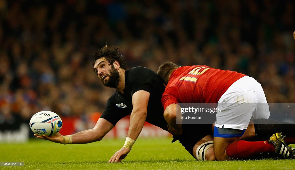 <a gi-track='captionPersonalityLinkClicked' href=/galleries/search?phrase=Sam+Whitelock&family=editorial&specificpeople=6070892 ng-click='$event.stopPropagation()'>Sam Whitelock</a> of New Zealand offloads despite the tackle of <a gi-track='captionPersonalityLinkClicked' href=/galleries/search?phrase=Nicolas+Mas&family=editorial&specificpeople=598314 ng-click='$event.stopPropagation()'>Nicolas Mas</a> of France during the 2015 Rugby World Cup Quarter Final match between New Zealand and France at Millennium Stadium on October 17, 2015 in Cardiff, United Kingdom.
