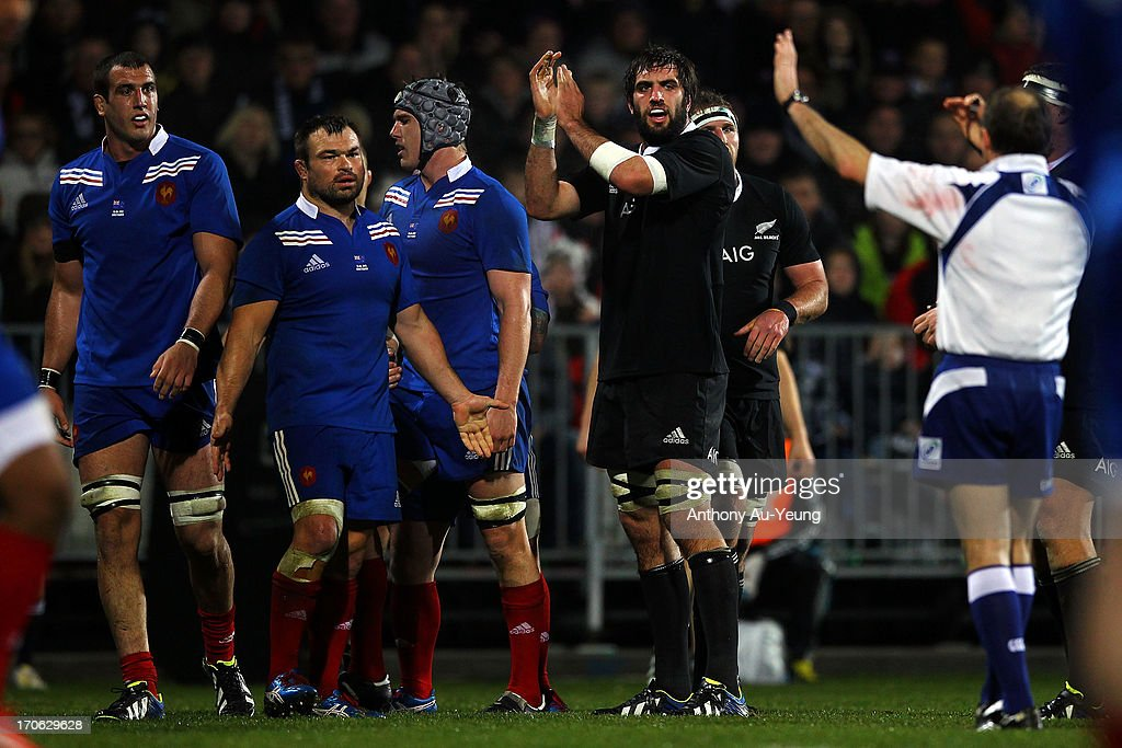 <a gi-track='captionPersonalityLinkClicked' href=/galleries/search?phrase=Sam+Whitelock&family=editorial&specificpeople=6070892 ng-click='$event.stopPropagation()'>Sam Whitelock</a> of the All Blacks and <a gi-track='captionPersonalityLinkClicked' href=/galleries/search?phrase=Nicolas+Mas&family=editorial&specificpeople=598314 ng-click='$event.stopPropagation()'>Nicolas Mas</a> of France react to a Referee's call during the International Test match between the New Zealand All Blacks and France at AMI Stadium on June 15, 2013 in Christchurch, New Zealand.