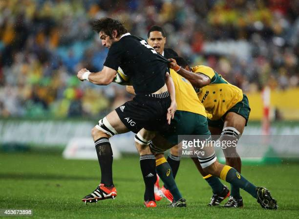 Sam Whitelock of the All Blacks is tackled during The Rugby Championship match between the Australian Wallabies and the New Zealand All Blacks at ANZ...