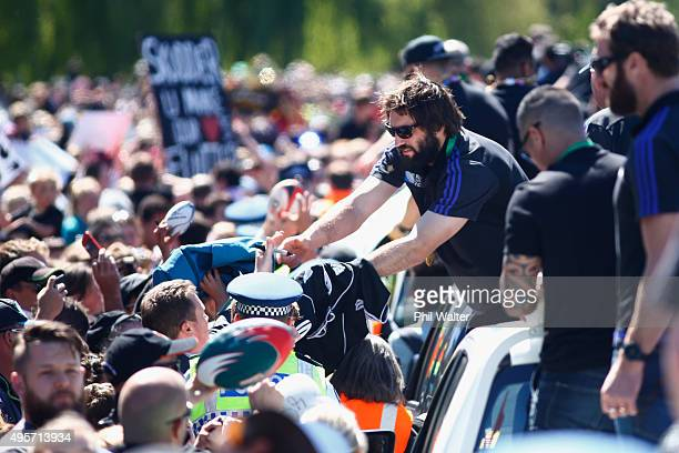 Sam Whitelock of the All Blacks meets fans as the team heads towards Hagley Park during the New Zealand All Blacks welcome home celebrations on...