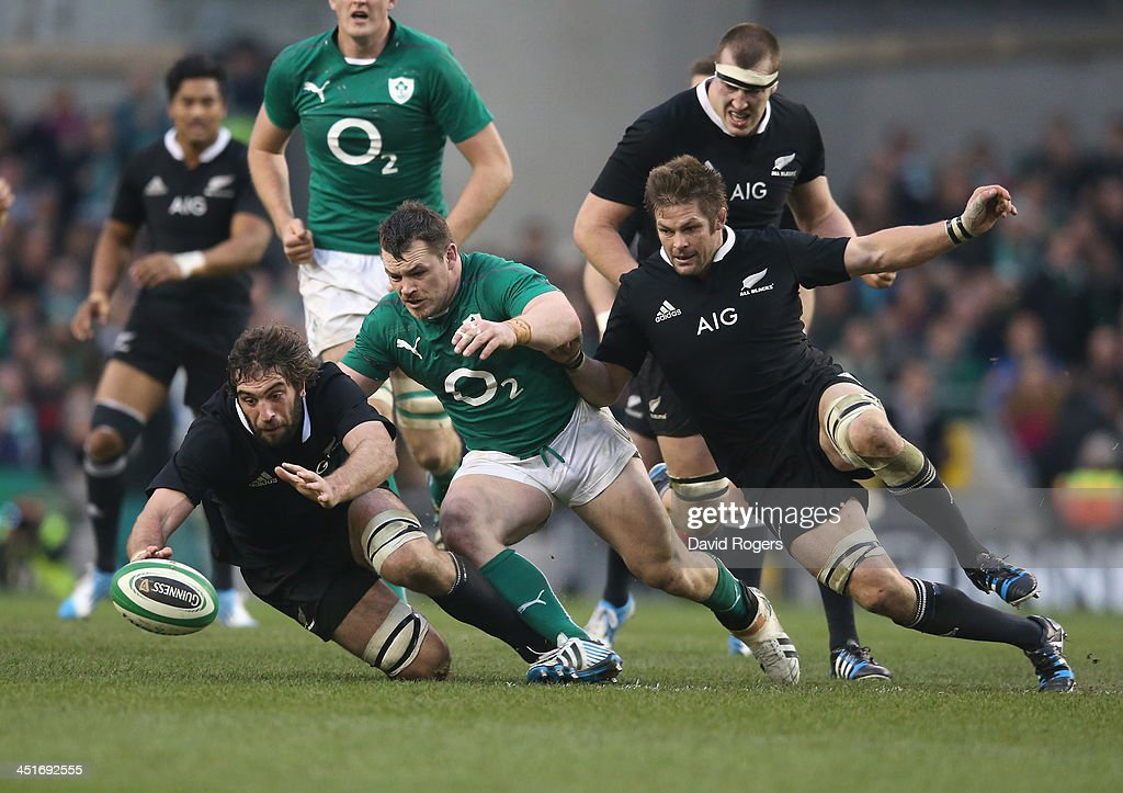 <a gi-track='captionPersonalityLinkClicked' href=/galleries/search?phrase=Sam+Whitelock&family=editorial&specificpeople=6070892 ng-click='$event.stopPropagation()'>Sam Whitelock</a> (L) of the All Blacks races <a gi-track='captionPersonalityLinkClicked' href=/galleries/search?phrase=Cian+Healy&family=editorial&specificpeople=4166531 ng-click='$event.stopPropagation()'>Cian Healy</a> and team mate <a gi-track='captionPersonalityLinkClicked' href=/galleries/search?phrase=Richie+McCaw&family=editorial&specificpeople=165235 ng-click='$event.stopPropagation()'>Richie McCaw</a> to the loose ball during the International match between Ireland and New Zealand All Blacks at the Aviva Stadium on November 24, 2013 in Dublin, Ireland.