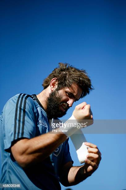 Sam Whitelock of the All Blacks straps his wrists during a New Zealand All Blacks training session at Toyota Park on October 28 2014 in Chicago...