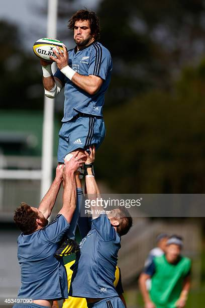 Sam Whitelock of the All Blacks takes the ball in the lineout during a New Zealand All Blacks training session at Trusts Stadium on August 12 2014 in...