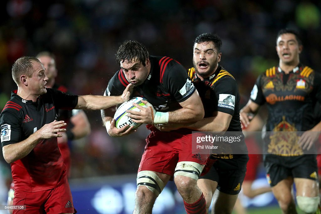 <a gi-track='captionPersonalityLinkClicked' href=/galleries/search?phrase=Sam+Whitelock&family=editorial&specificpeople=6070892 ng-click='$event.stopPropagation()'>Sam Whitelock</a> of the Crusaders is tackled by James Lowe of the Chiefs during the round 15 Super Rugby match between the Chiefs and the Crusaders at ANZ Stadium on July 1, 2016 in Suva, Fiji.