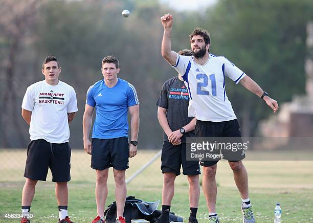 Sam Whitelock throws a ball during a game of Pétanque during the New Zealand All Blacks activities session held at Hyde Park High School on September...