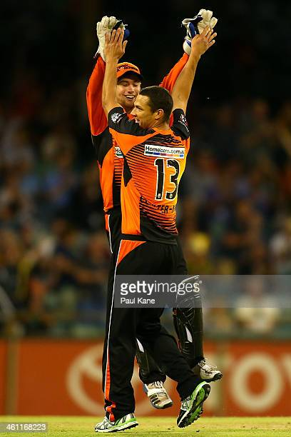 Sam Whiteman and Nathan CoulterNile of the Scorchers celebrate the dismissal of Owais Shah of the Hurricanes during the Big Bash League match between...