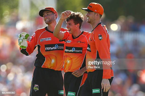 Sam Whiteman Jhye Richardson and Ashton Turner of the Scorchers celebrate the wicket of Jordan Silk of the Sixers during the Big Bash League match...