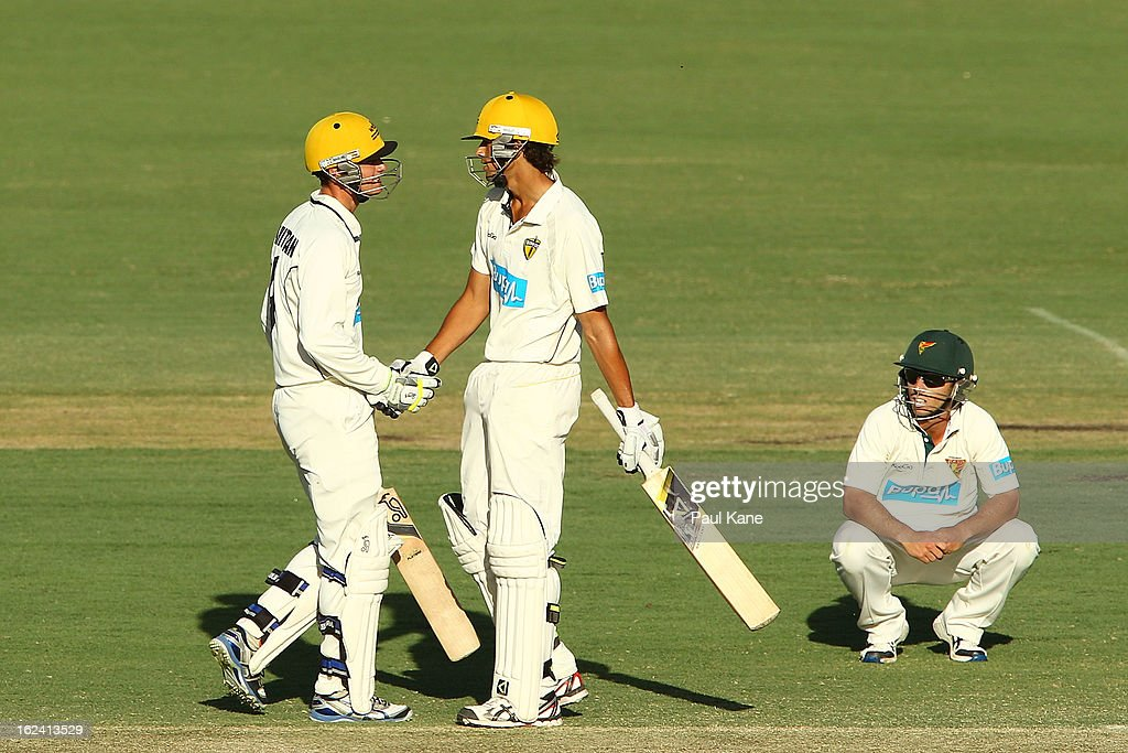 Sam Whiteman of the Warriors congratulates Ashton Agar after scoring his half century as Jon Wells of the Tigers looks on during day three of the Sheffield Shield match between the Western Australia Warriors and the Tasmania Tigers at WACA on February 23, 2013 in Perth, Australia.