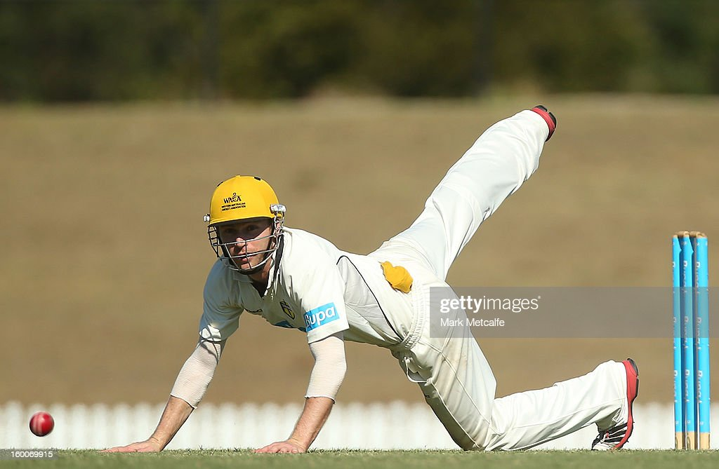Sam Whiteman of the Warriors dives for the ball during day two of the Sheffield Shield match between the New South Wales Blues and the Western Australia Warriors at Blacktown International Sportspark on January 25, 2013 in Sydney, Australia.